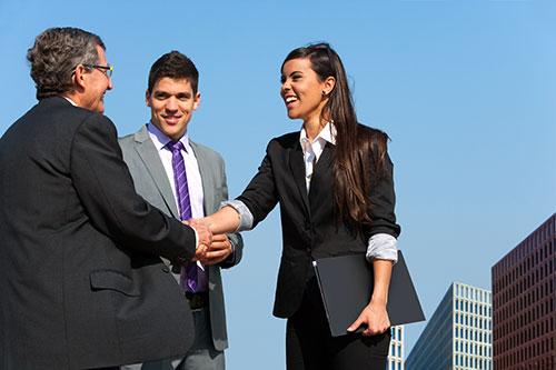 Quickbooks consultants shaking hands before training begins.
